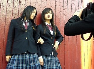 Mami, left, and Rina get in a few extra poses with Japanese media on March 21.