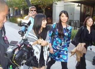 Manoeri, left center, exits the Club Nokia on Thursday, including paparazzi. (Photo by G.A. Carroll)